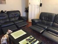Leather reclining sofas in navy blue x 2