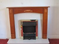 Fire Surround in Teak, Fioritto Roggi Marble, Cambridge Electric Fire, Black Blenheim Fret.