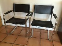 CHROME AND BLACK LEATHER CHAIRS