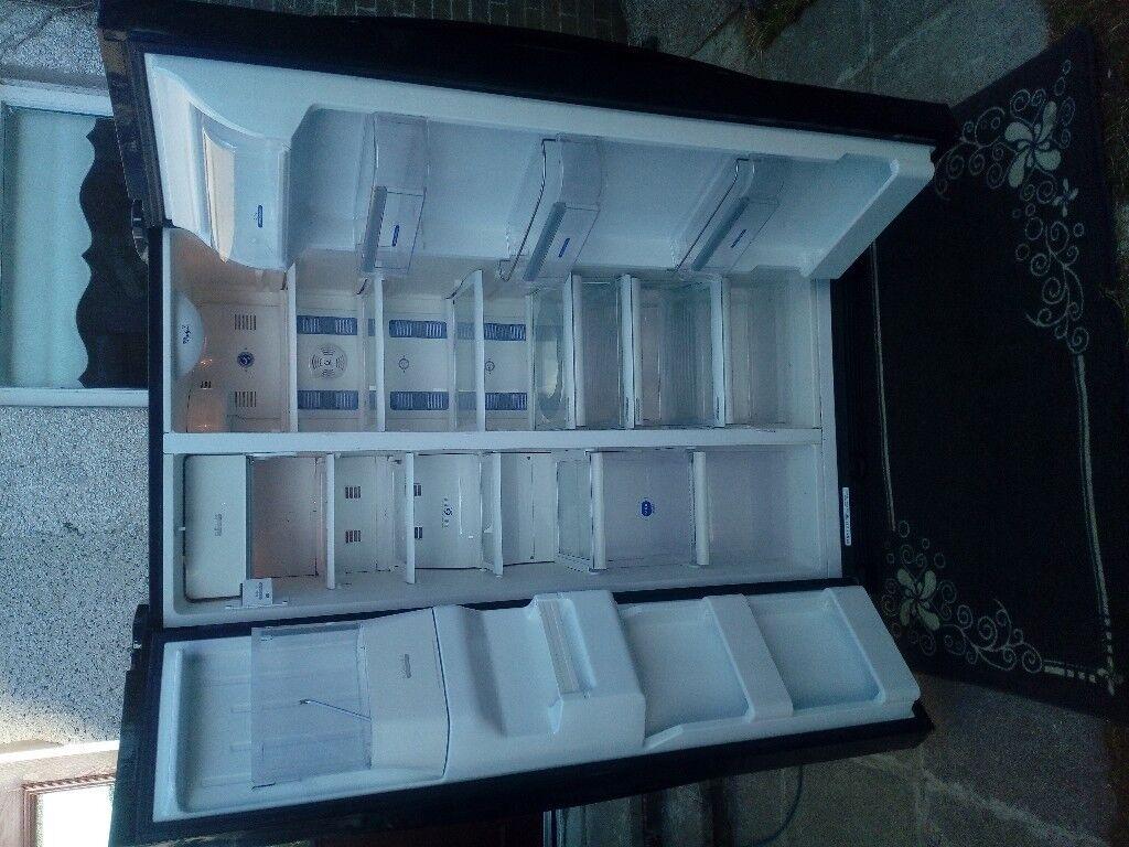 Gloss black whirlpool American fridge freezer with water dispenser ...