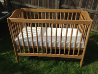 Wooden cot with foam safety mattress and 3 fitted sheets