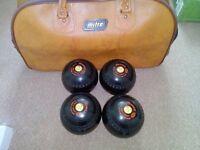 Five sets of lawn bowls for sale