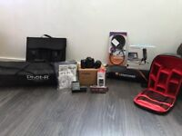 Canon EOS 70D Digital SLR Camera with 18-55mm STM Lens and Gear
