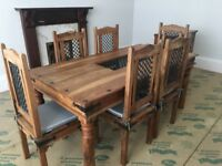 Solid wood dining table and 6 chairs with matching solid wood sideboard.