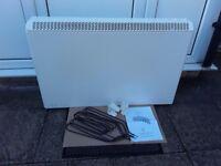 3 year old Elnur 2:55 kw electric storage radiator,feet,booklet & 4 spare elements in vgc .