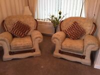 Three piece suite in beige with 2 additional armchairs in cream