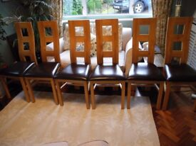 Six oak and leather dining chairs
