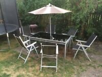LARGE GLASS TOP TABLE 6 CHAIRS AND PARASOL