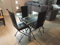 Hand made, wrought iron dining table set with 4 chairs