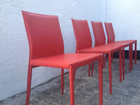 Four faux leather red dining chairs