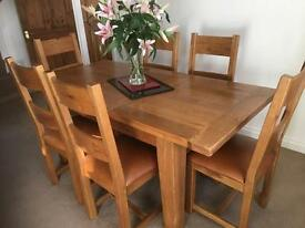 Solid oak dining table £170