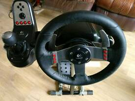 Logitech G27 steering wheel and pedals with wheel stand pro