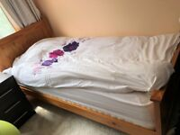 Single wooden frame bed with a new mattress for sale as no longer required £50