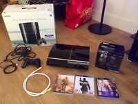 80gb PS3 (Playstation 3)+controller+Aimon Wireless Mouse Controller+3 games:MW2,MW3,Last of us
