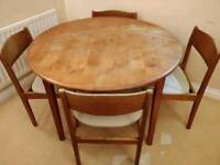 Extendable dining table with 4 chairs for sale