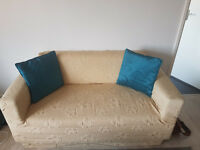 Two seat sofa with sofa cover and pillows