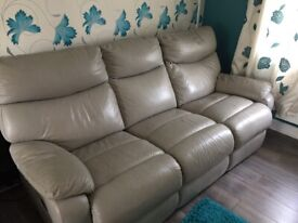 Cream leather sofas -3 seaters x2 , reclining