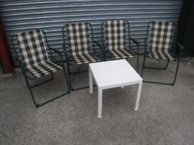 4 folding deck chairs and table.