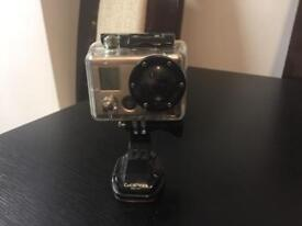 Go Pro Hero 2 Motorsports Edition camera and accessories