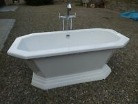 Bath and freestanding taps.