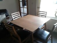 Table and 4 chairs in good condition.