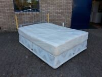 king size sprung edge divan bed base with 10 inch thick clean mattress and modern headboard