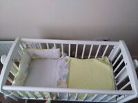 Rocking baby crib...in excellent condition. White ..selling for a friend