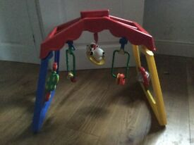 Baby activity centre,brightly coloured,baby lays underneath and plays with hanging toys,mirror etc