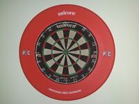 Unicorn PDC dart board with matching PDC surround and boxed darts