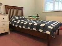Stylish single wooden bed frame. Teak colour. Tall slatted back. Mattress also available.