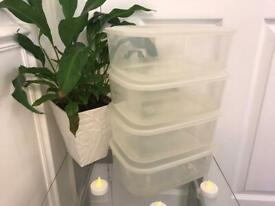 4 clear plastic storage boxes with lids