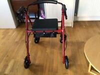 Four wheel rollator/walking frame
