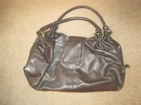 Medium sized dark brown handbag as seen in photo