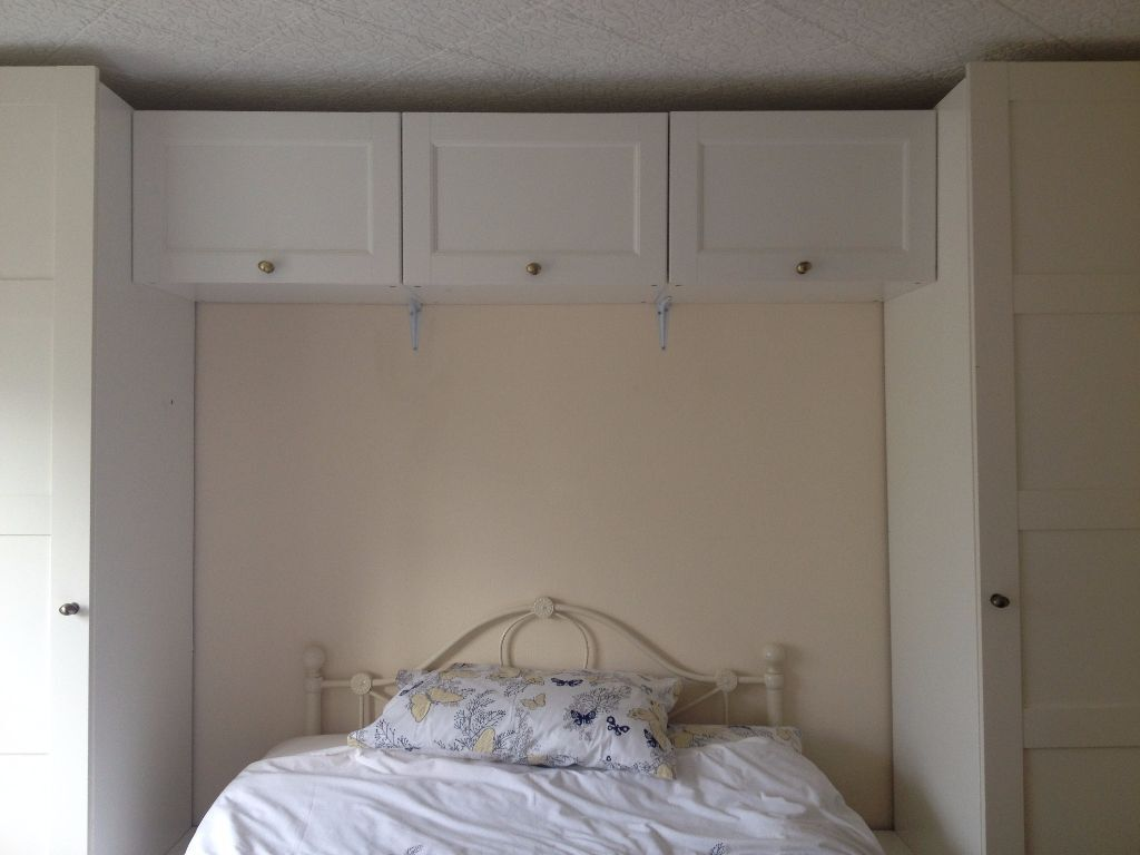 ikea white pax over bed wardrobe and cupboard storage in. Black Bedroom Furniture Sets. Home Design Ideas