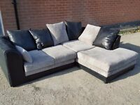 Superb black and grey cord corner sofa. 1 month old. clean and tidy. can deliver