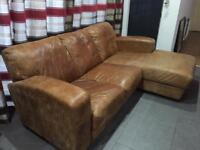 Tan L-shaped leather settee / sofa for sale