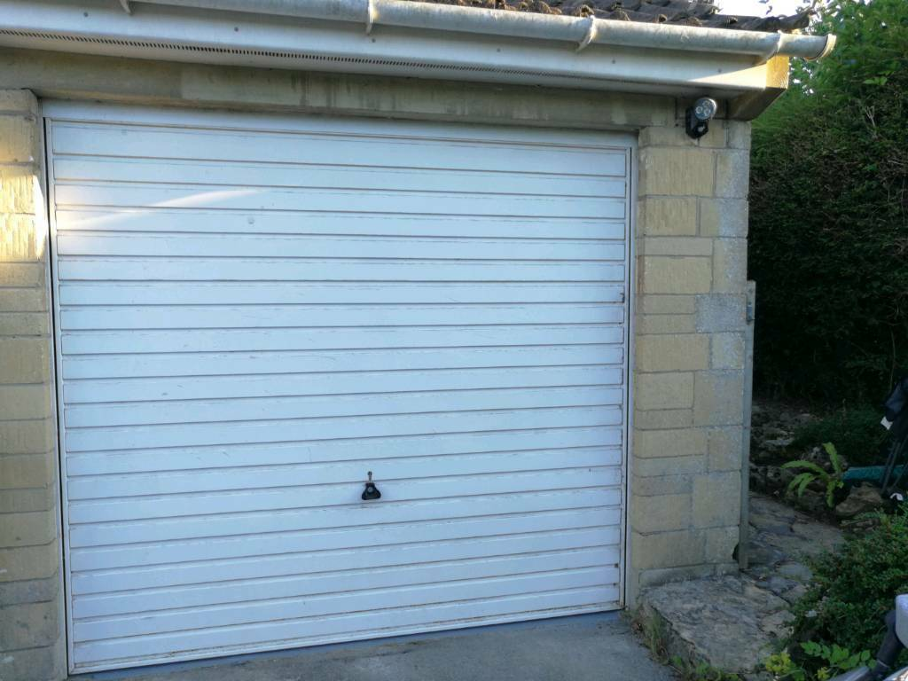 Single garage door and frame