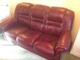 Leather three seater, burgundy. £100