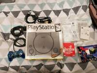 Original boxed PlayStation with games