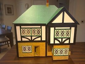 Dolls house, wooden, hand made with furniture. 60cms wide, 40 cms deep and 40 cms high