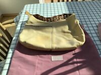 Three various shapes and sizes of used Radley ladies hand bags