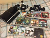 Sony PS3, 12 games, 3 controllers and a charger!