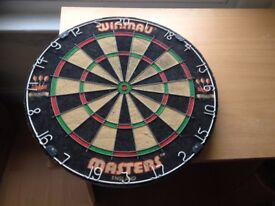Professional dart board in great condition, hardly used
