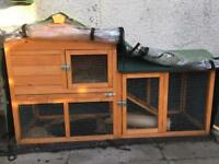 Rabbit hutch with rain cover