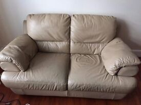 For Sale: two-seater leather sofa, excellent condition. Collection only