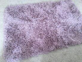 Beautiful shaggy purple rug