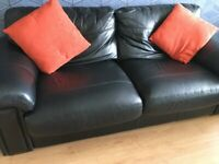 Three seater black leather sofa