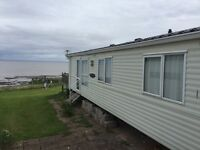 BK Caprice for sale at St Audries Bay Holiday Club, Front row plot with views of the green and sea