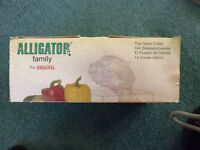 Alligator - The Onion Cutter. One simple cutting action eliminates tears. Easily cleaned.