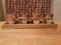 4 tea lights in wooden holder